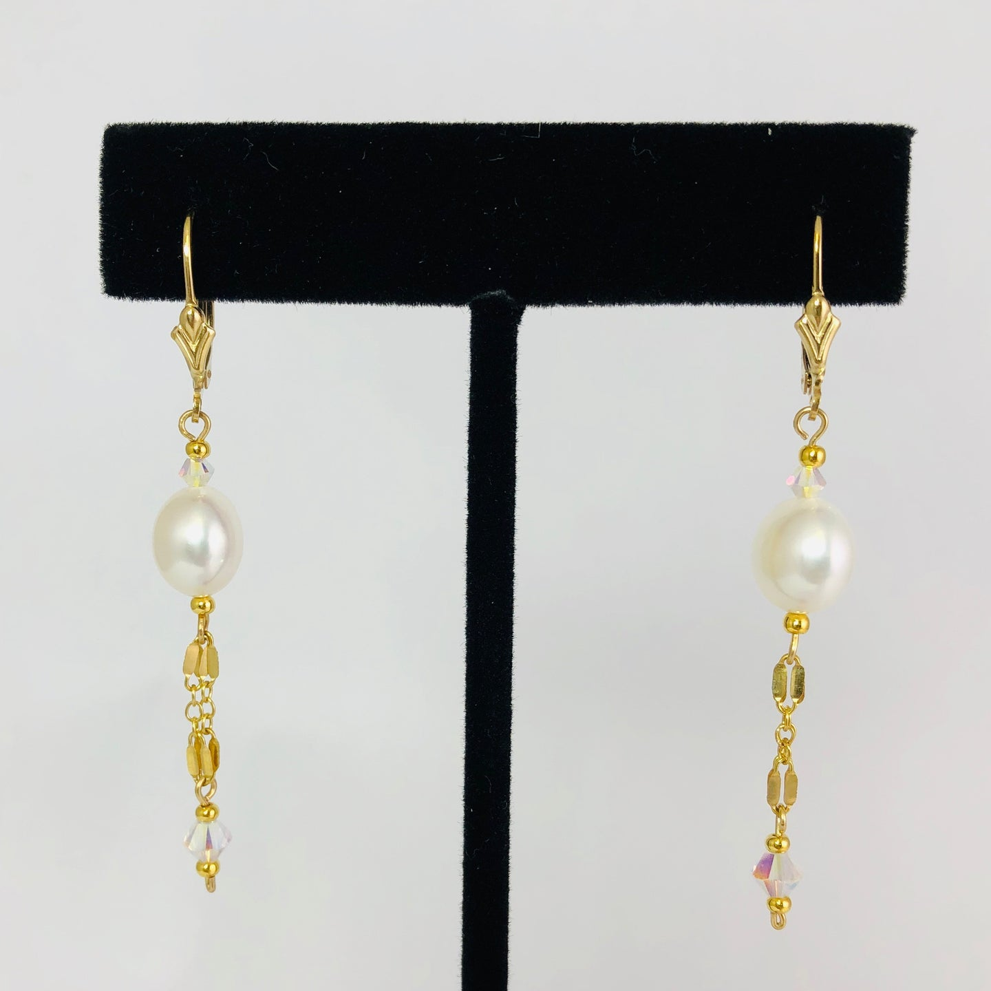 Earrings, EG ivory drip, by Cynthia Bloom