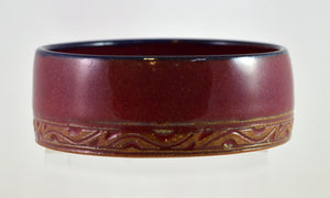 Straight sided red bowls by Roy Brown
