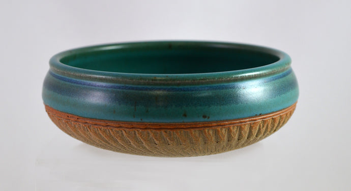 Turquoise flat bowls with brown texture by Roy Brown