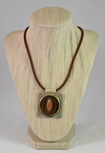 Silver and Petrified Wood pendant on Leather by Christina Chomel
