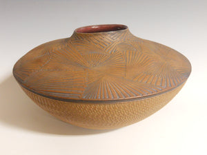 Closed in basket, palm frond by Roy Brown