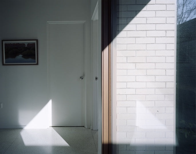 Shadow over door & brick wall(563124006) photography by David Johnson