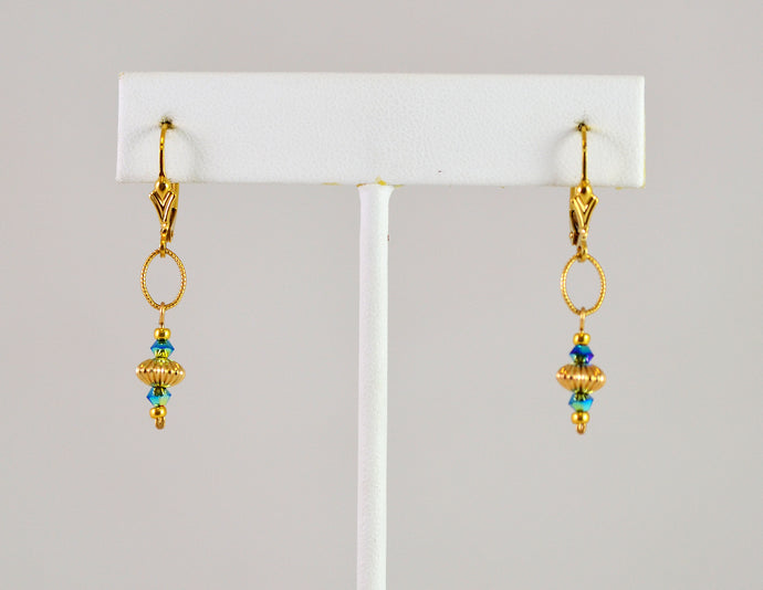 Earrings in gold and turquoise by Cynthia Blook
