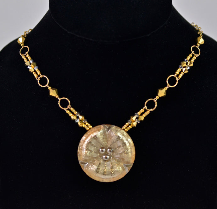 Gold button necklace by Cynthia Bloom
