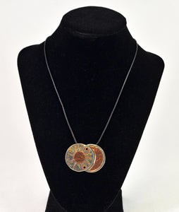 Silver and Copper Circles on Leather by Christina Chomel