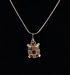 Silver turtle necklace by Christina Chomel