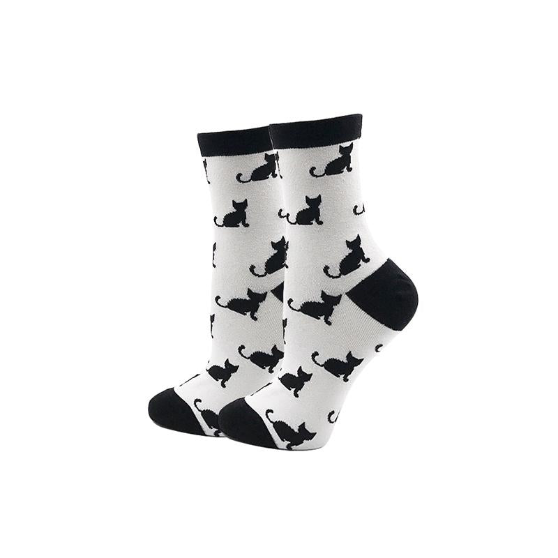 White socks with black cats.  Novelty socks for women.