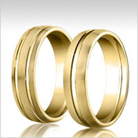 10K yellow gold grooved wedding bands