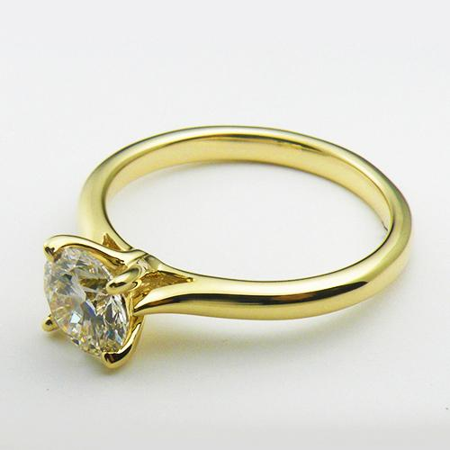 14K Yellow Gold solitare engagement ring with a 1.0 ct lab created diamond.