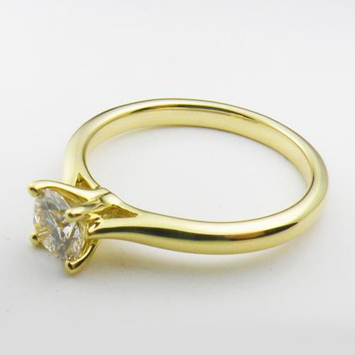 14K Yellow Gold solitare engagement ring with a 0.75 ct lab created diamond.