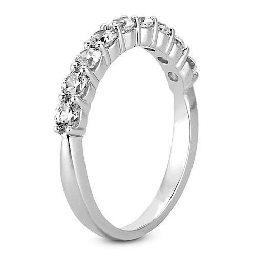 Platinum 2.5mm prong set  women's 0.63 carats diamond wedding bands.