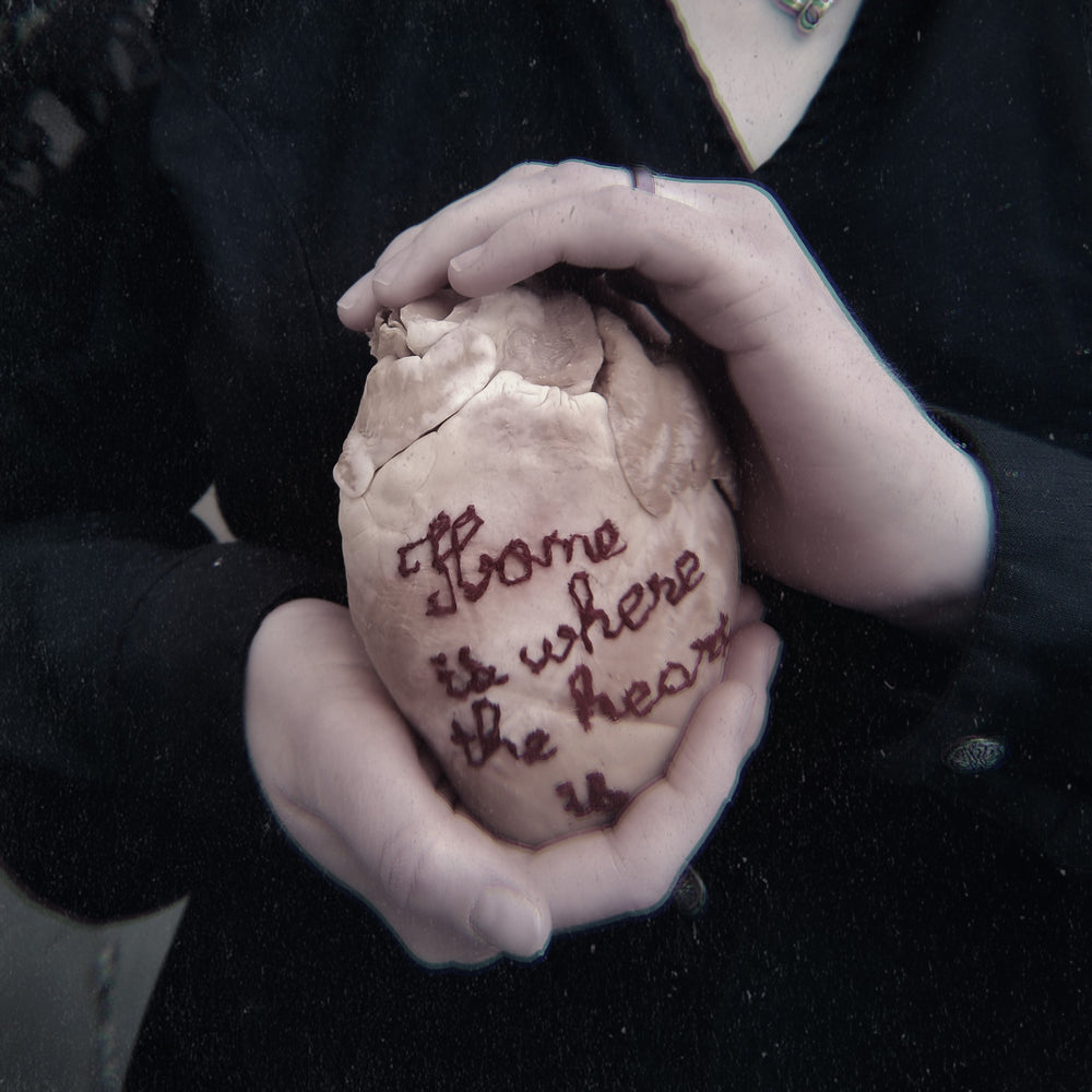 "Real fluid preserved wet specimen heart embroidered with ""Home is where the heart is"""