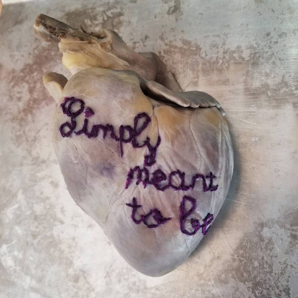 "Real fluid preserved wet specimen heart embroidered with ""Simply meant to be"""