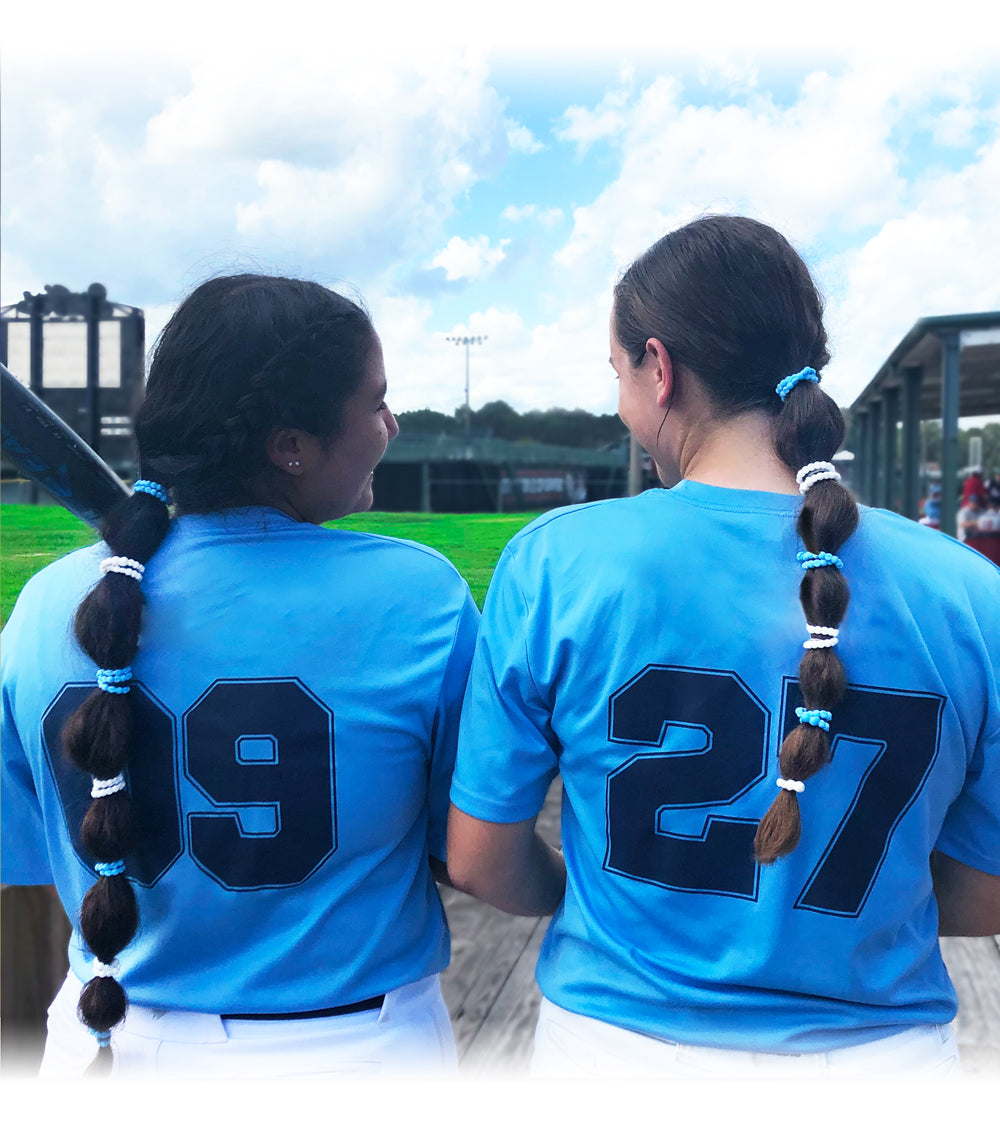 3 Softball Hairstyles That Are Perfect For The Game