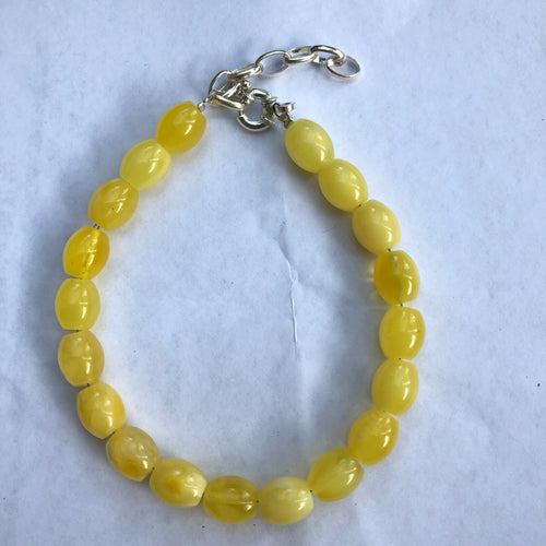 8X10 mm. Oval Milky Amber Beads Bracelet