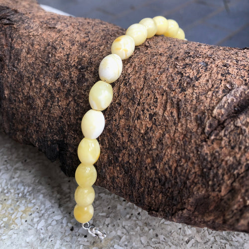 9X11 mm. Oval Milky Amber Beads Bracelet