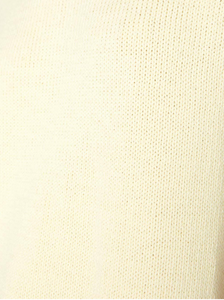 Close up of the knitting of a  pale yellow crew neck sweater.