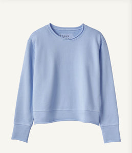 A flat-lay image of a long sleeve light blue sweater.