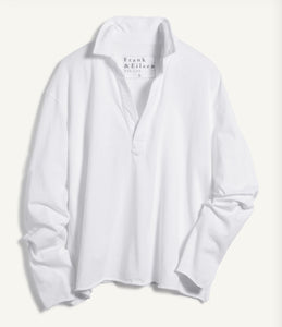 A flat-lay image of a long sleeve white top with a v-neck and collar.