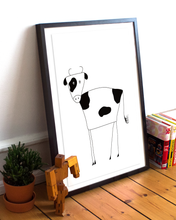 Load image into Gallery viewer, Framed black and white illustration of a cow on the floor with a plant and books