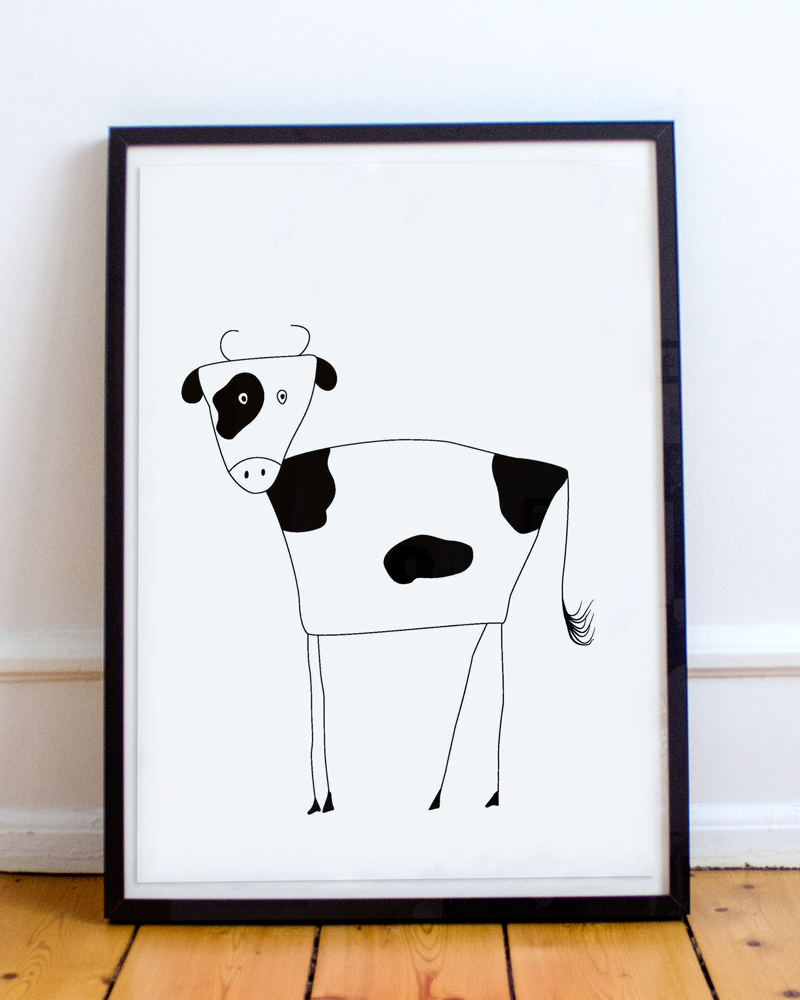 Framed black and white illustration of a cow.