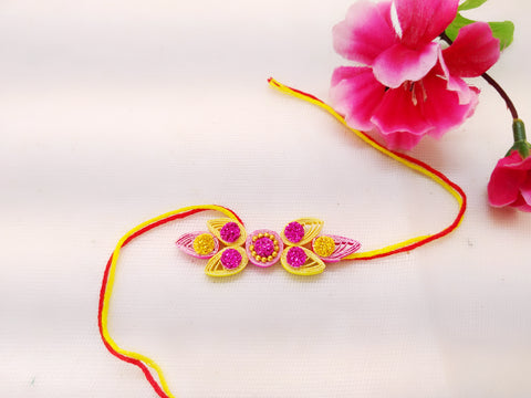 Rakhi - Quilled Rakhi - Flower and leaf - Pink and yellow - Ahaeli