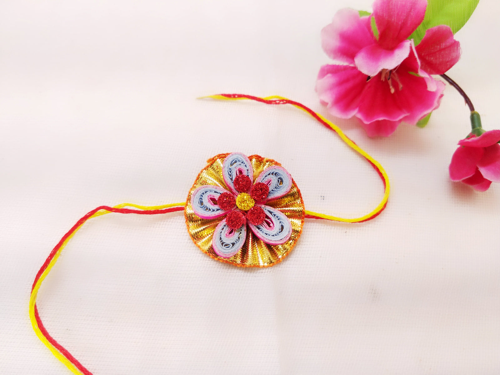 Rakhi - Quilled Rakhi - Flower design - Golden, white, and red - Ahaeli