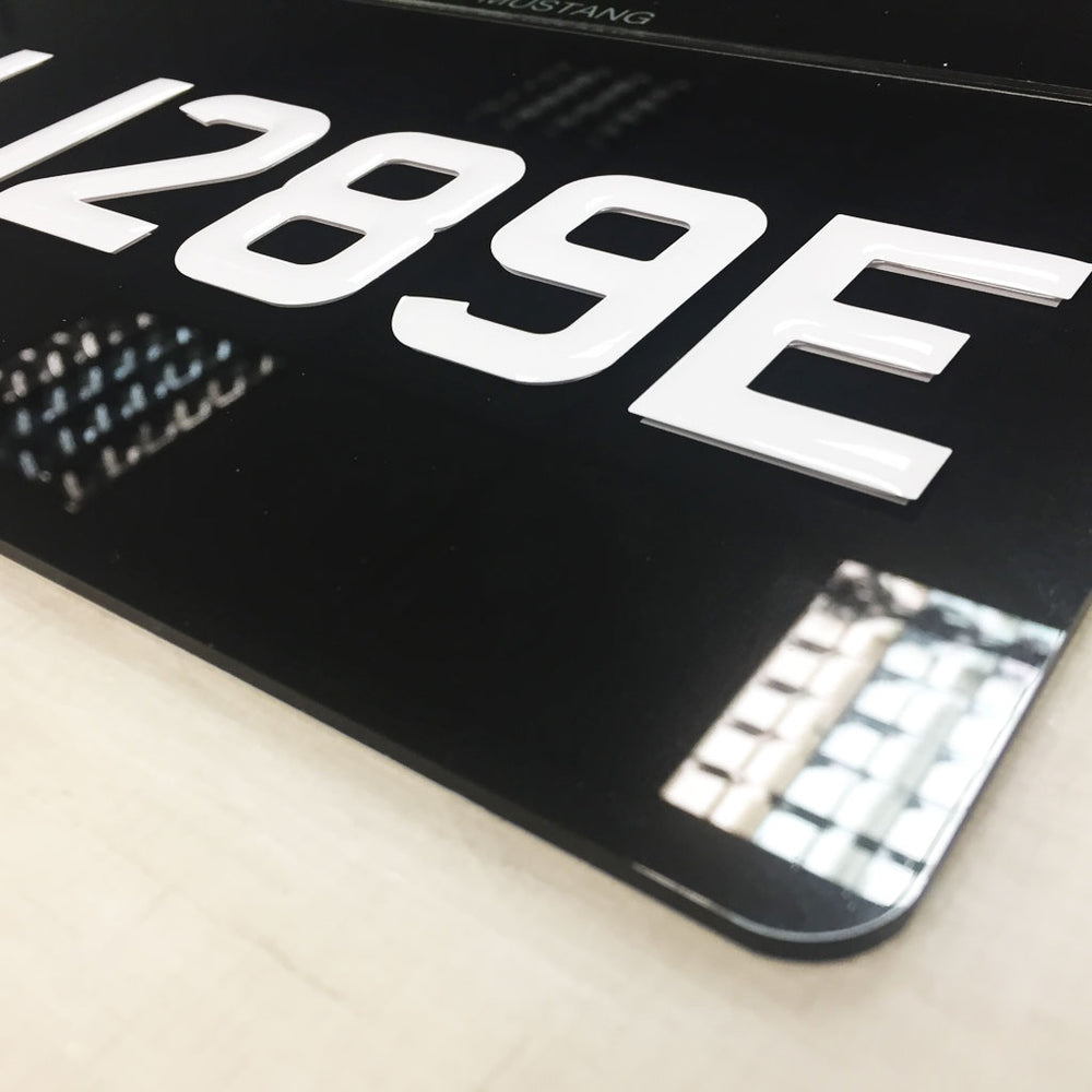 White Gel number plates on black
