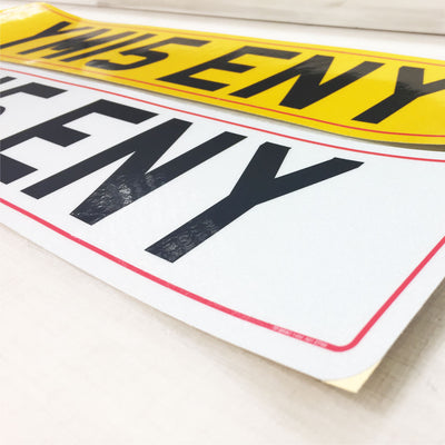 Set of self adhesive number plates
