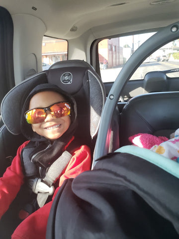 Ellis in backseat with shades