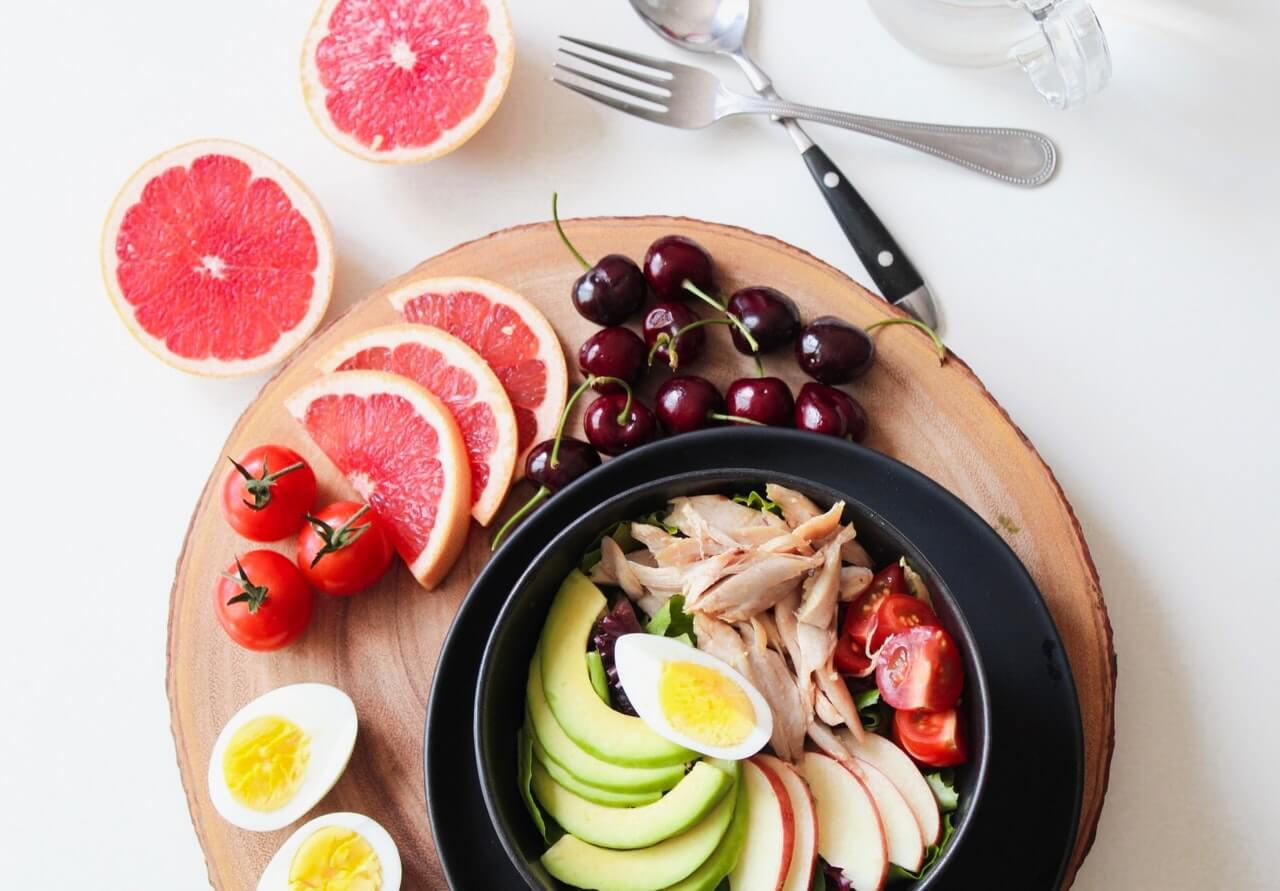 Main picture for the article how to boost your immune system naturall. The photo contains grapefruit, a bowl of vegetables, boiled eggs, cranberries. Author: Trang Doan.
