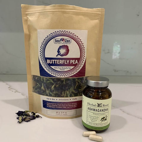 Butterfly pea tea bag and an ashwagandha bottle of capsules.