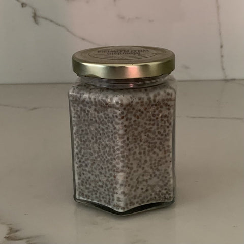 Chia seeds with oat milk and agave left in a glass container overnight.