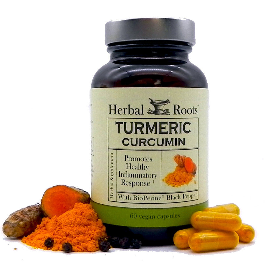 Herbal Roots label of Turmeric Curcumin, the bottle has curcumin powder and pepper around it.