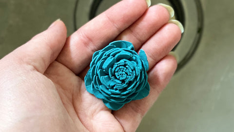 Blue flower after being sanitized with Clorox wipe