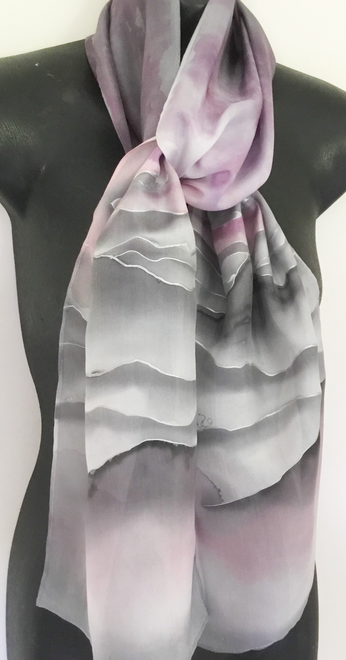 silver outlined stripes or hills on a grey and dusky pink silk scarf
