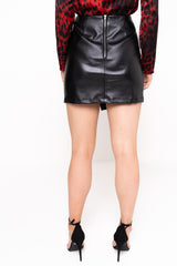 Model Against Plain Background Wearing Asymmetric PU Mini Skirt Cropped Back Image