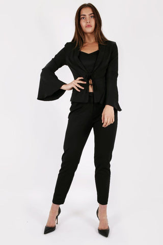 Model Against Plain Background Wearing Bell Sleeve Blazer in Black Front Image