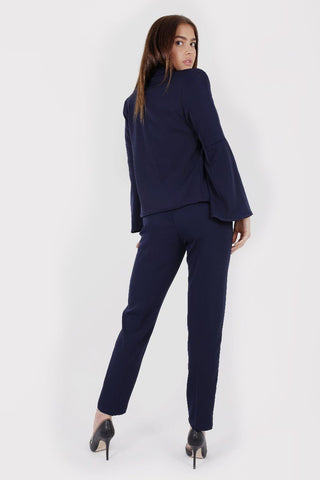Model Against Plain Background Wearing Bell Sleeve Blazer in Navy Back Image