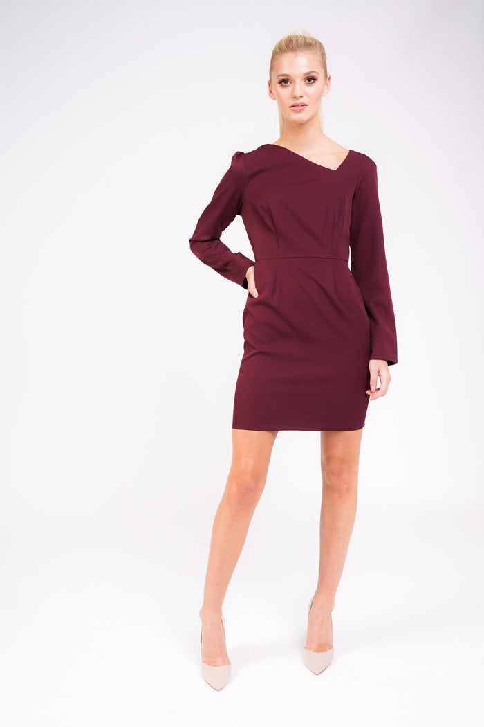 Model Against Plain Background Wearing Asymmetric Dress In Berry Front Image