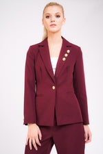 Model Against Plain Background Wearing Berry Blazer With Gold Button Detail Front Cropped Image