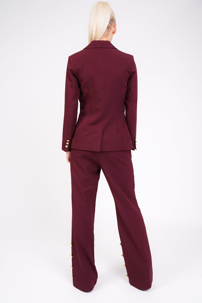 Model Against Plain Background Wearing Berry Blazer With Gold Button Detail Back Image