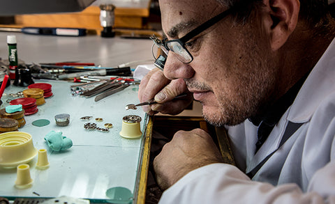 Man preforming a watch face repair