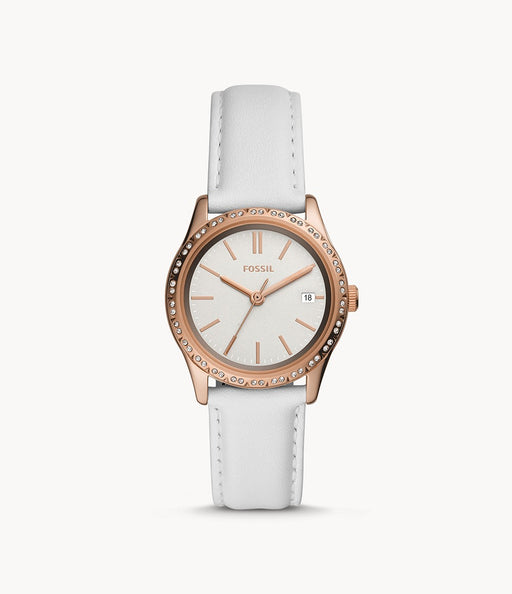 The smooth white leather strap attaches to the rose gold tone case and bezel. The rose gold tone stands out due to the matching rose gold hour markers and hands against the white face of the watch. The day date is also displayed.