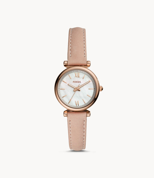 Rose gold-tone stainless steel case with a blush leather strap. Fixed rose gold-tone bezel. Mother of pearl dial with luminous rose gold-tone hands and index hour markers. Roman numerals mark the 6 and 12 o'clock positions.