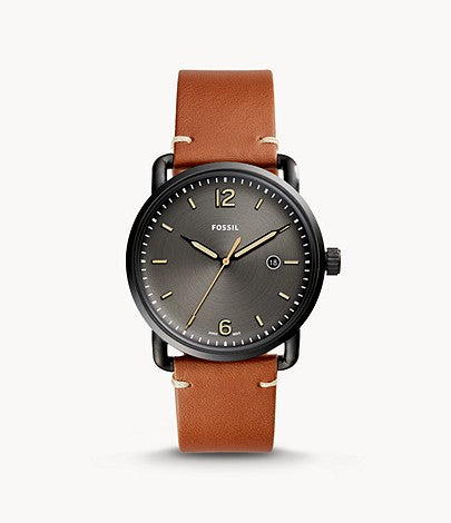 The brown leather strap attaches to the black tone stainless steel case that frames the black face of the watch. The luminescent hour markers and hands are easily visible in light or darkness.