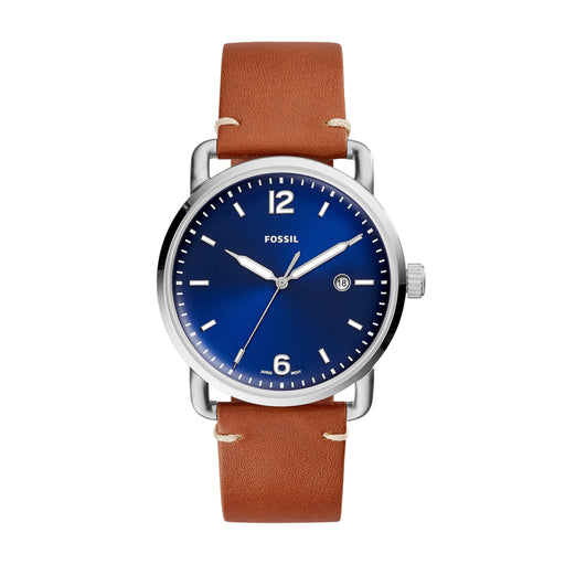 The brown leather strap attaches to the silver tone stainless steel case that frames the blue face of the watch. The white luminescent hour markers and hands are easily visible in light or darkness.
