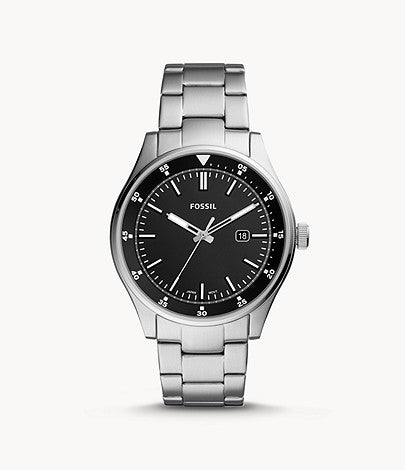 Silver-tone stainless steel case with a silver-tone stainless steel bracelet. Fixed silver-tone stainless steel bezel. Black dial with silver-tone hands and index hour markers. Minute markers around the outer rim. Dial Type: Analog. Luminescent hands. Date display at the 3 o'clock position.