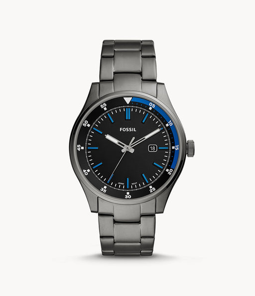 Smoke stainless steel case with a smoke stainless steel bracelet. Fixed smoke stainless steel bezel. Black dial with silver-tone hands and index hour markers. Minute markers around the outer rim. Dial Type: Analog. Luminescent hands. Date display at the 3 o'clock position.