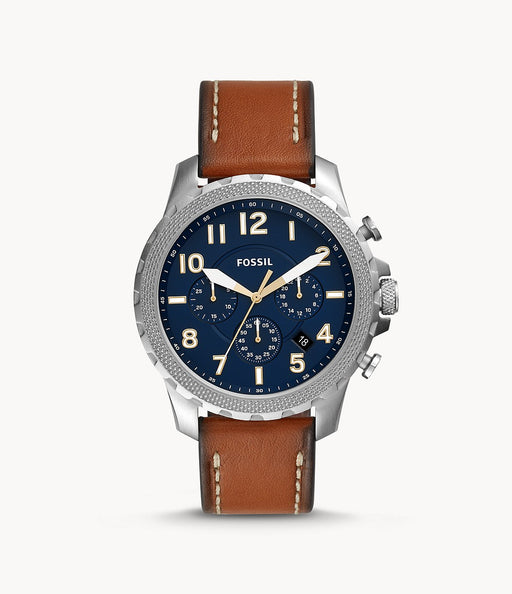 The smooth brown leather strap with burnt edges attaches to the silver tone stainless steel case and textured bezel. This frames the navy blue face with off white hour numerals and large hands and 3 sub dials.